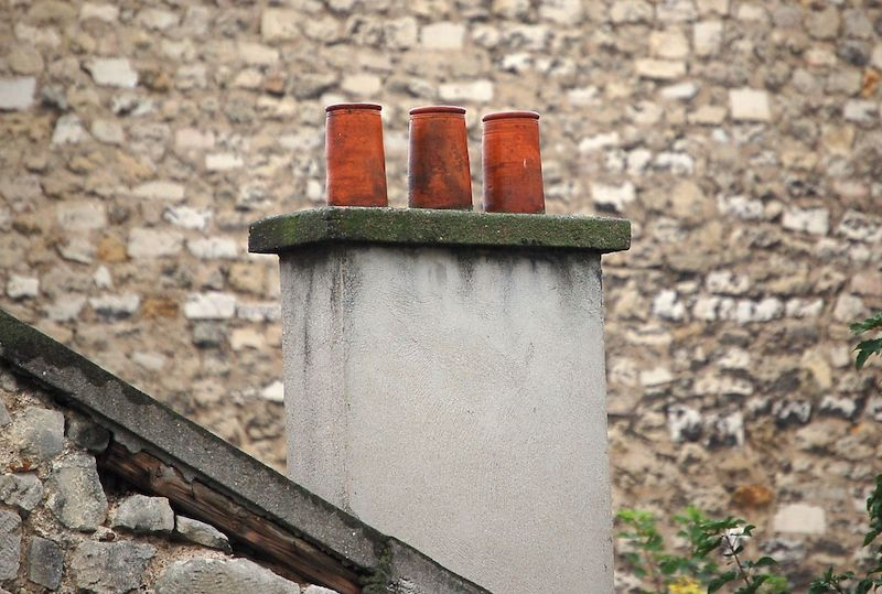 small chimney on a stone house