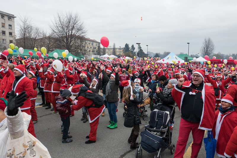 crowd dressed as santa clause in front of the Regina Margherita hospital in Turin, Italy