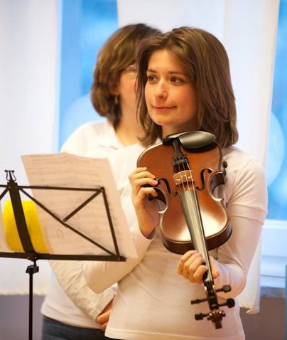 young lady holding a violin