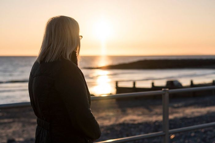 woman looking at a sunset