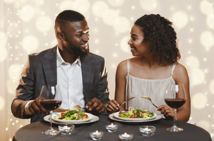 afro american couple having a romantic dinner