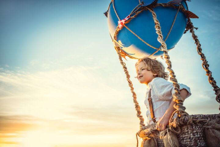 young boy on a hot-air balloon