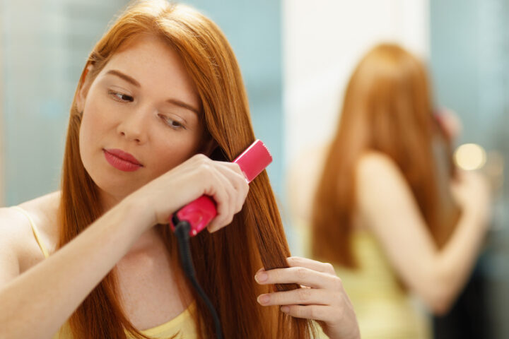 red-headed woman brushing her hair