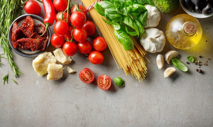 various Italian food ingredients such as tomato, spaghetti, parmesan