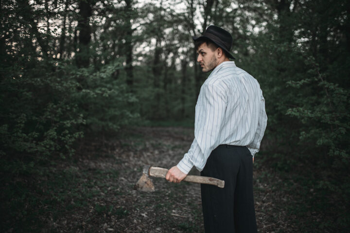 man with axe in woods