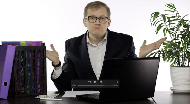 man sitting at his desk