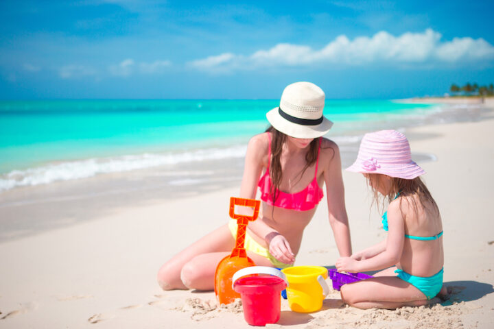 mum and daughter building a sand castle