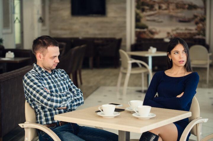 unhappy couple seating in a café