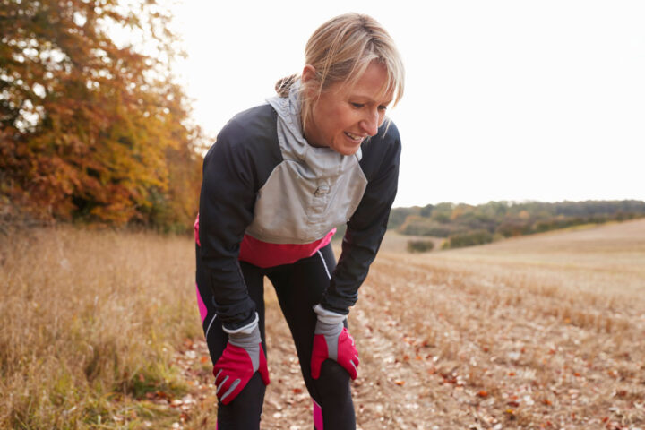 running woman pauses to breath