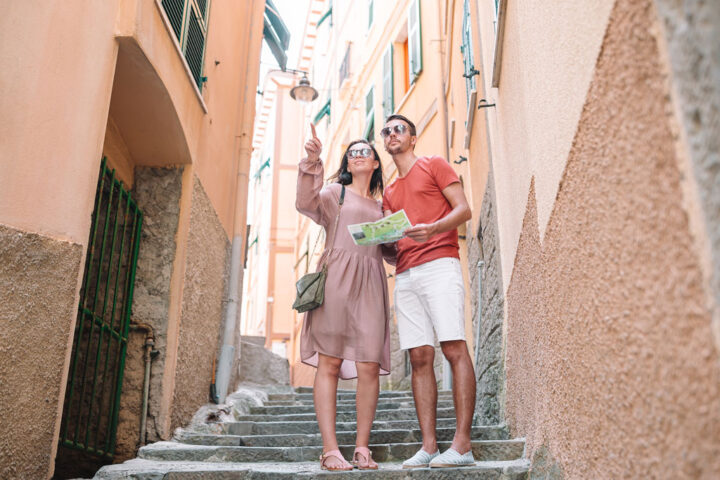 couple with map exploring Italian town