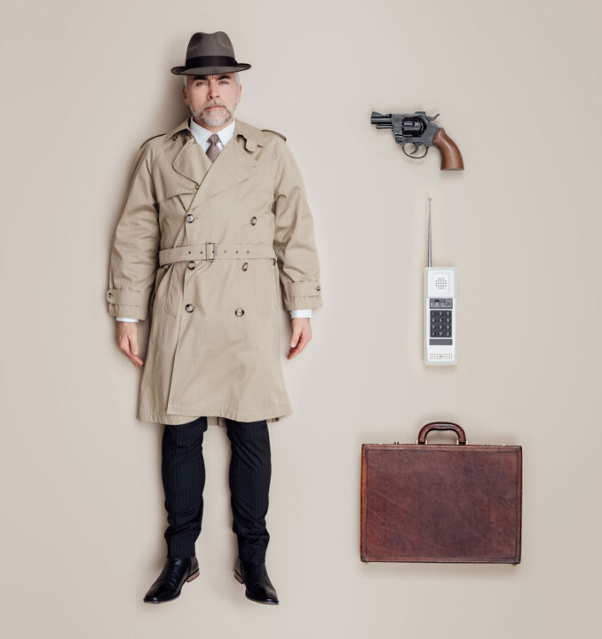 secret agent with gun, phone and suitcase