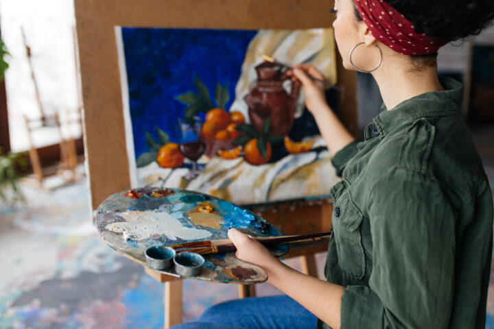 woman painting still life