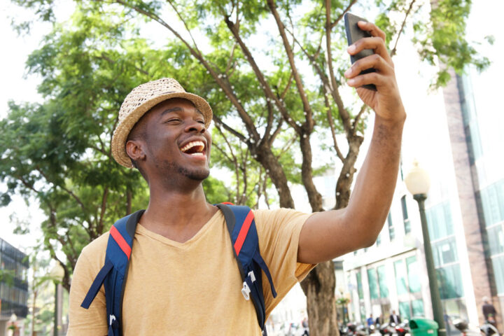 young tourist smiles and takes a selfie
