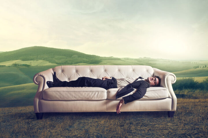 male sleeping on a couch outdoor