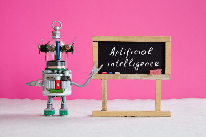 robot next to sign that reads artificial intelligence