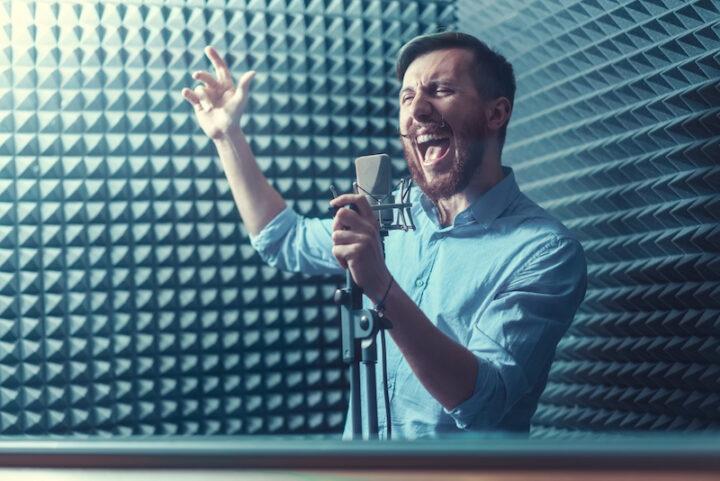 man signing in recording studio