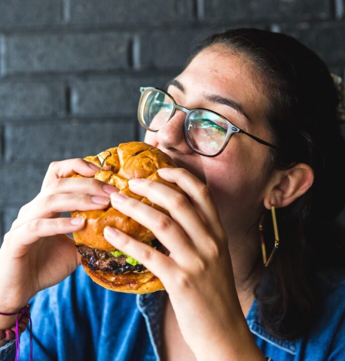 girl eating a big burger