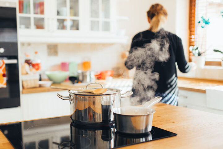steam coming out of saucepans in the kitchen