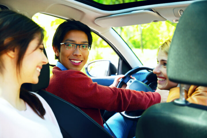 friends smiling inside the car