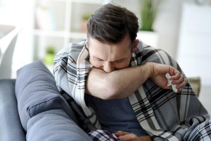 man caughing