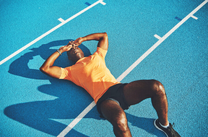 sport man exhausted lying on the ground
