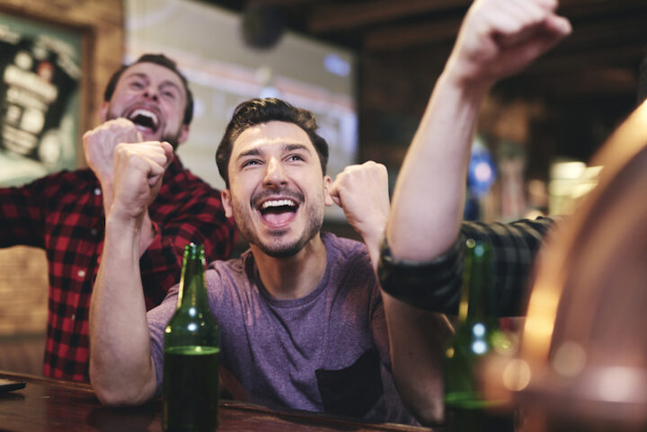 Enthusiast of soccer fan clenching fist