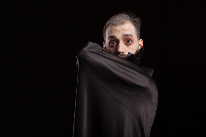 Man dressed up in dracula costume for halloween.