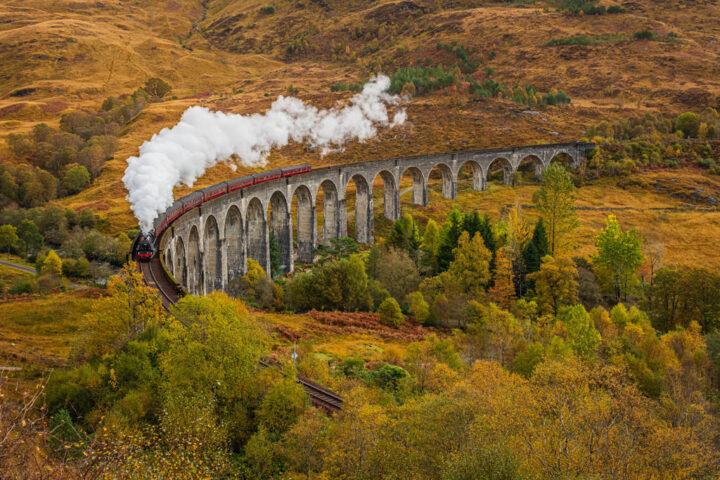 Steam Train on Glenfinnan Viaduct, Scotland in Autumn