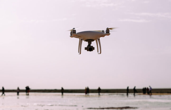 Drone flying in the air above water