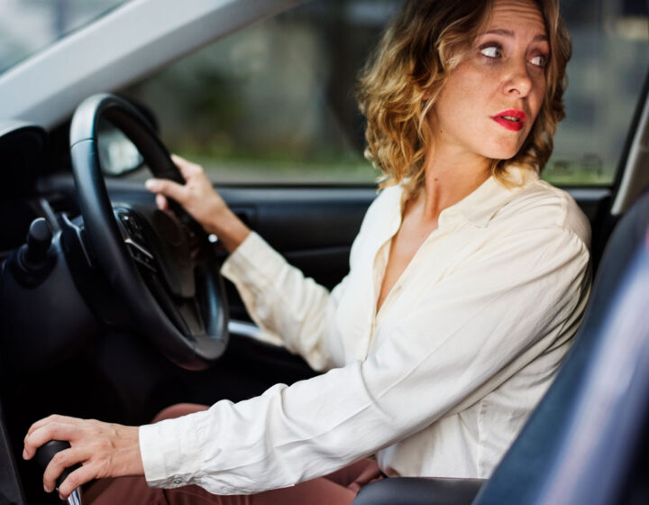 Woman driving a car in reverse
