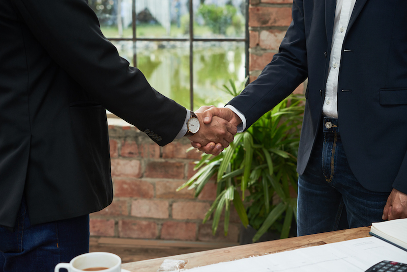 Cropped image of business colleagues shaking hands to confirm deal