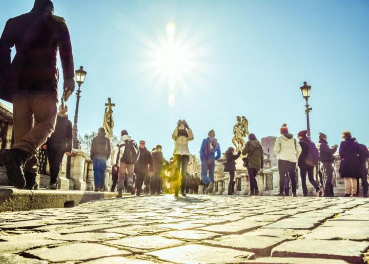 Crowd Of People Street Walking On Bridge Of Saint Angelo In Rome, Italy
