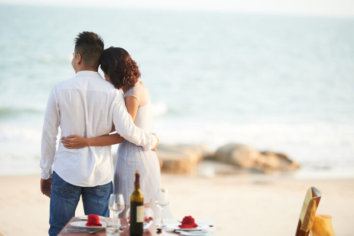 Young couple having romantic dinner on the beach