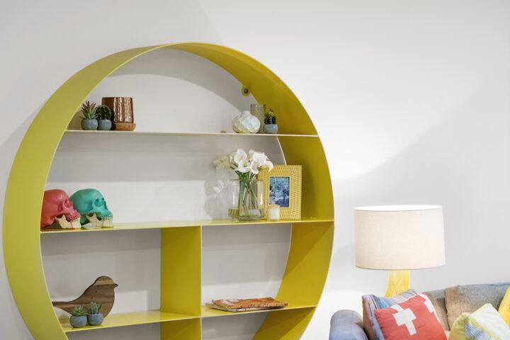 modern yellow shelf covered in knick knacks