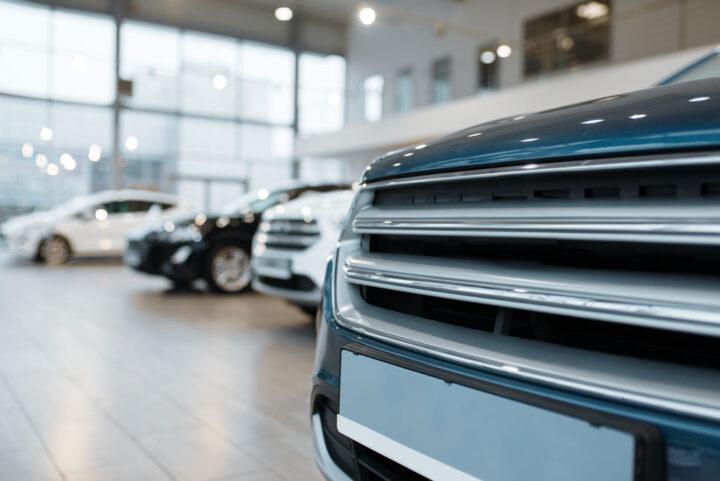 Car dealership, closeup view on automobile radiator grille