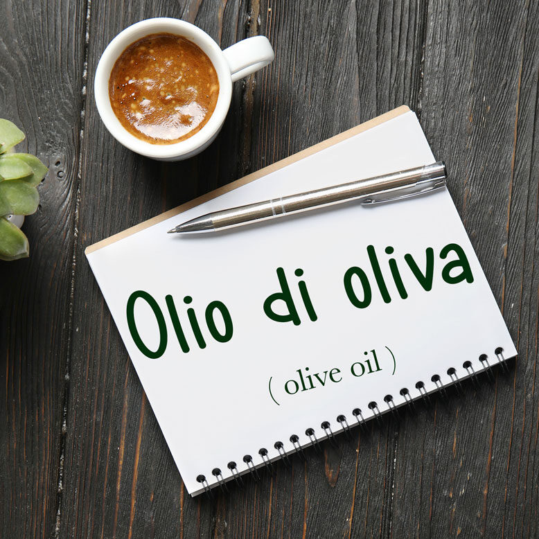 """cover image with the words """"olio di oliva"""" and their translation written on a notepad next to a cup of cofee"""