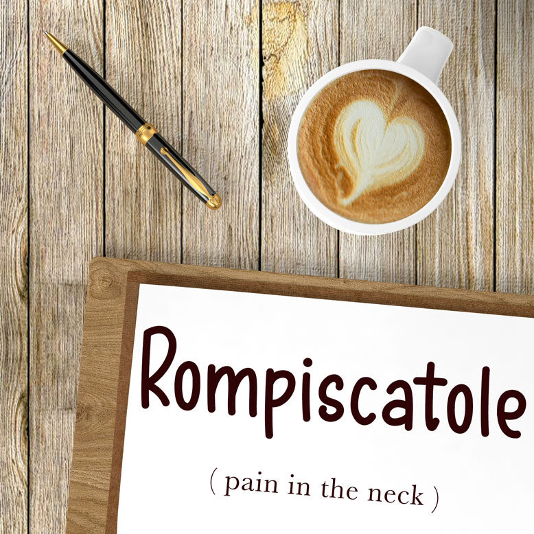 """cover image with the word """"rompiscatole"""" and its translation written on a notepad next to a cup of cofee"""