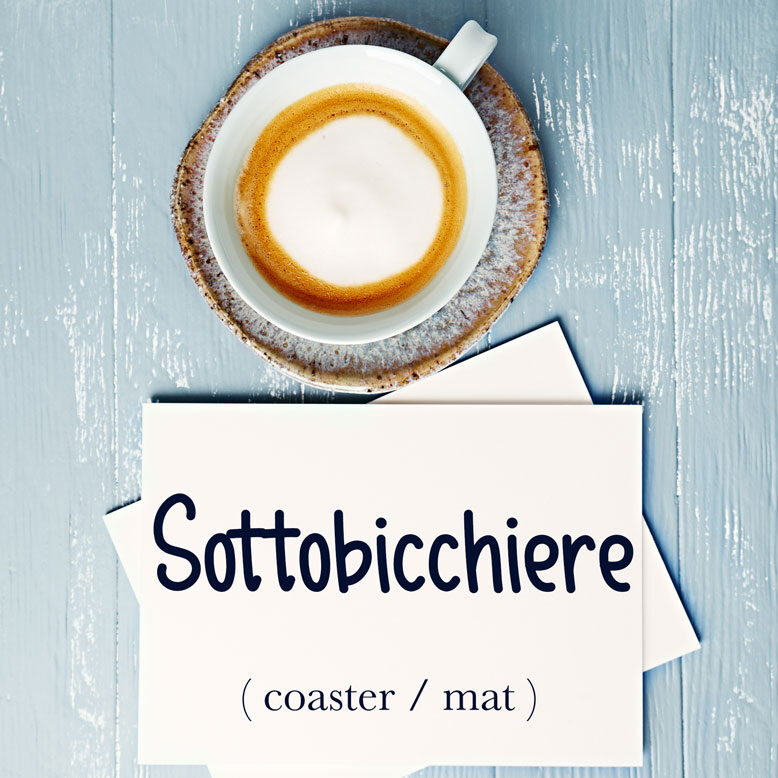cover image with the word sottobicchiere and its translation written on a notepad next to a cup of cofee