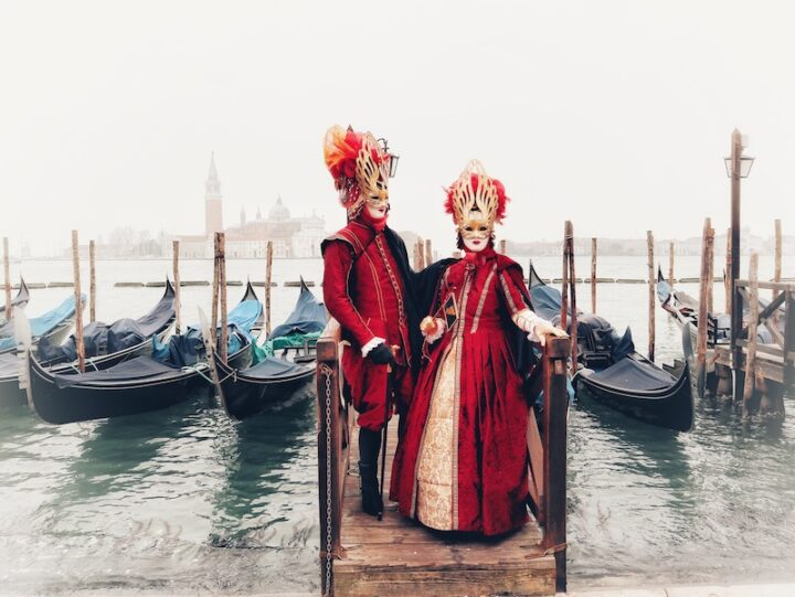 Two masked figures in costume in Venice, Italy