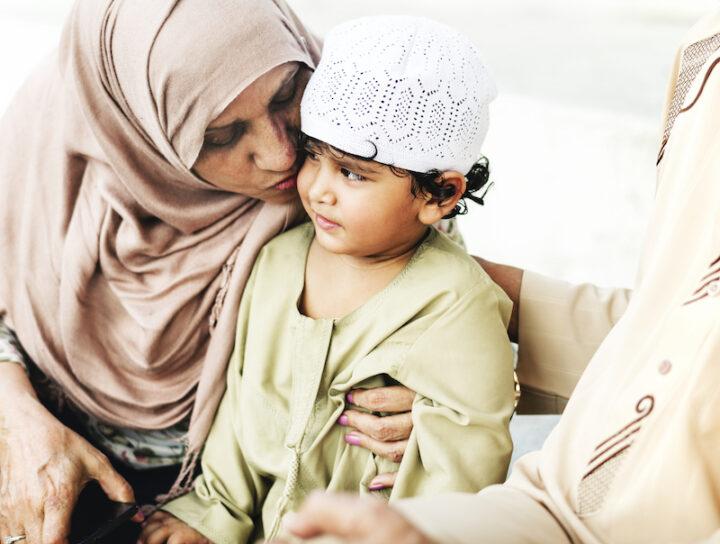 Muslim grandparents with their grandchild