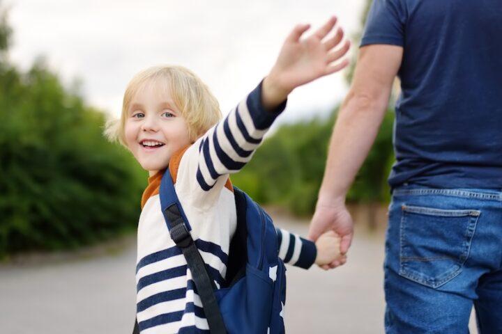 Little boy waving goodbye