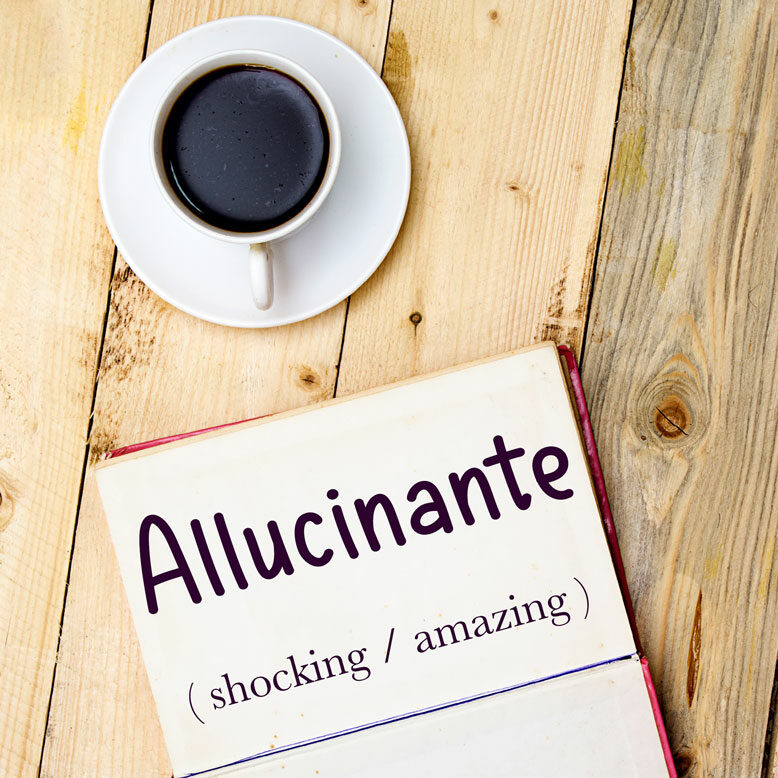 """cover image with the word """"allucinante"""" and its translation written on a notepad next to a cup of cofee"""
