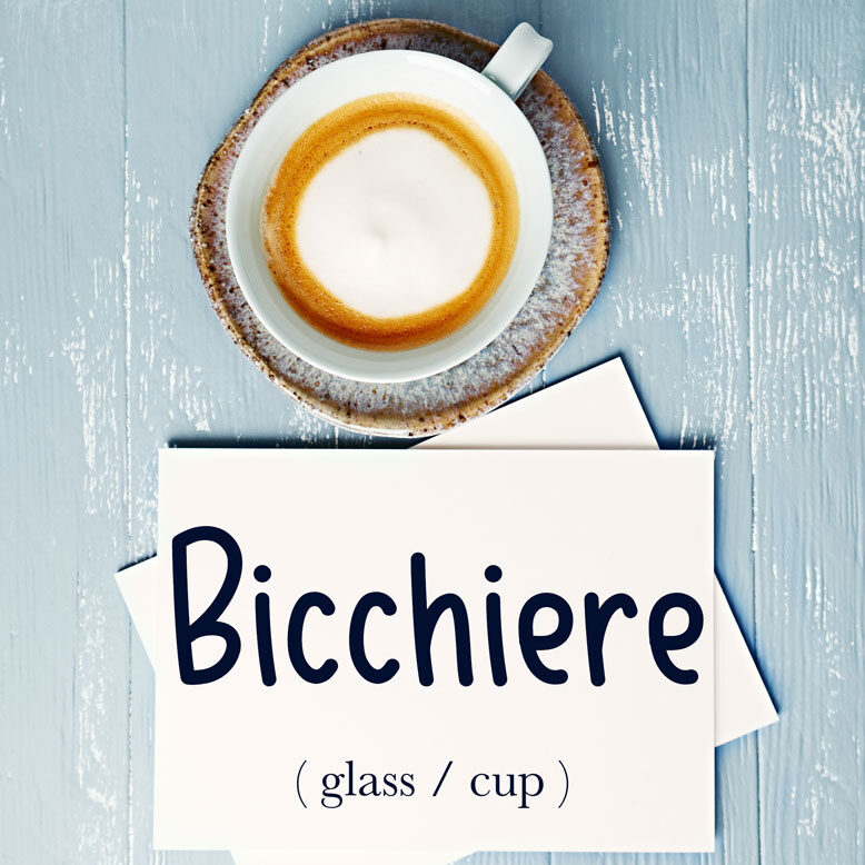 """cover image with the word """"bicchiere"""" and its translation written on a notepad next to a cup of cofee"""