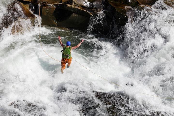 Man jumping into rapids