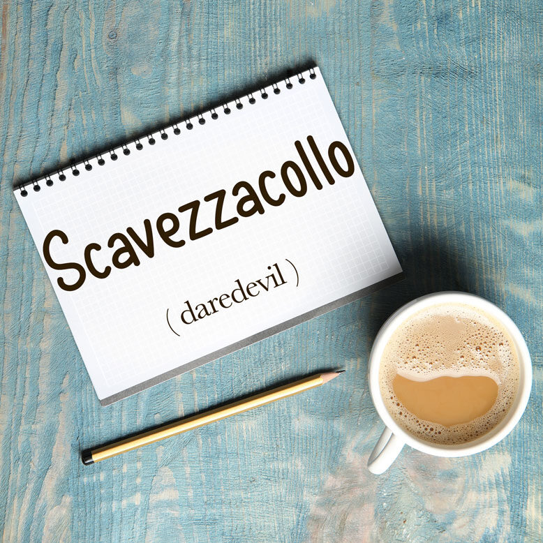 """cover image with the word """"scavezzacollo"""" and its translation written on a notepad next to a cup of cofee"""