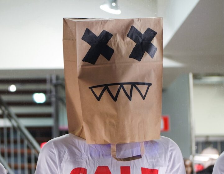 mannequin with paper shopping bag on his head