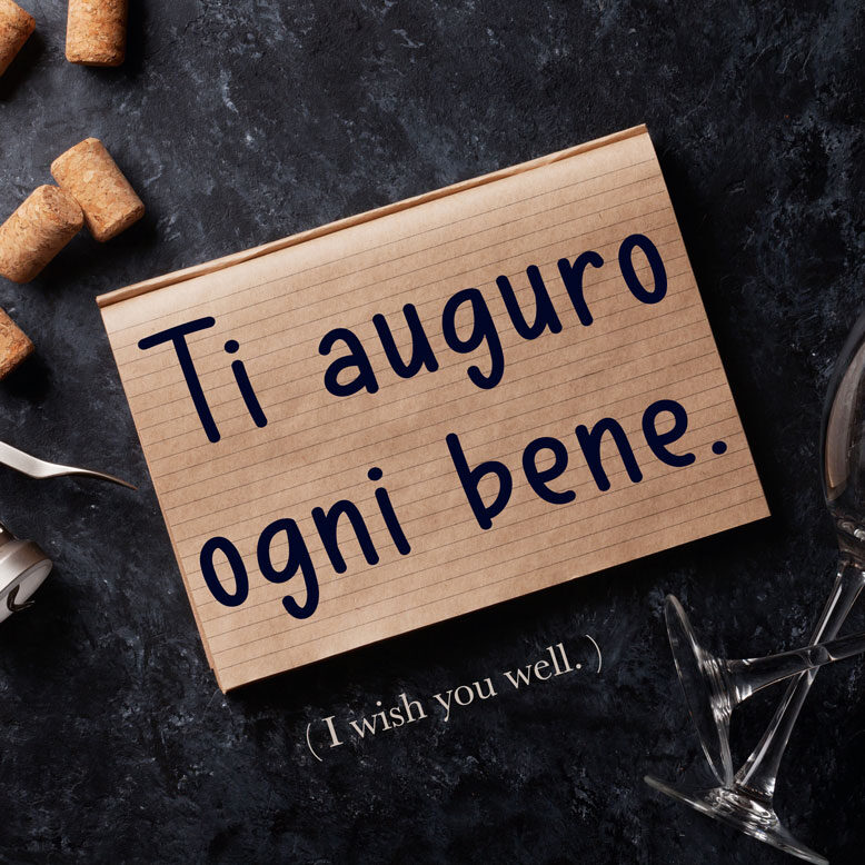 cover image with the phrase and its translation written on a notepad next to a glass of wine