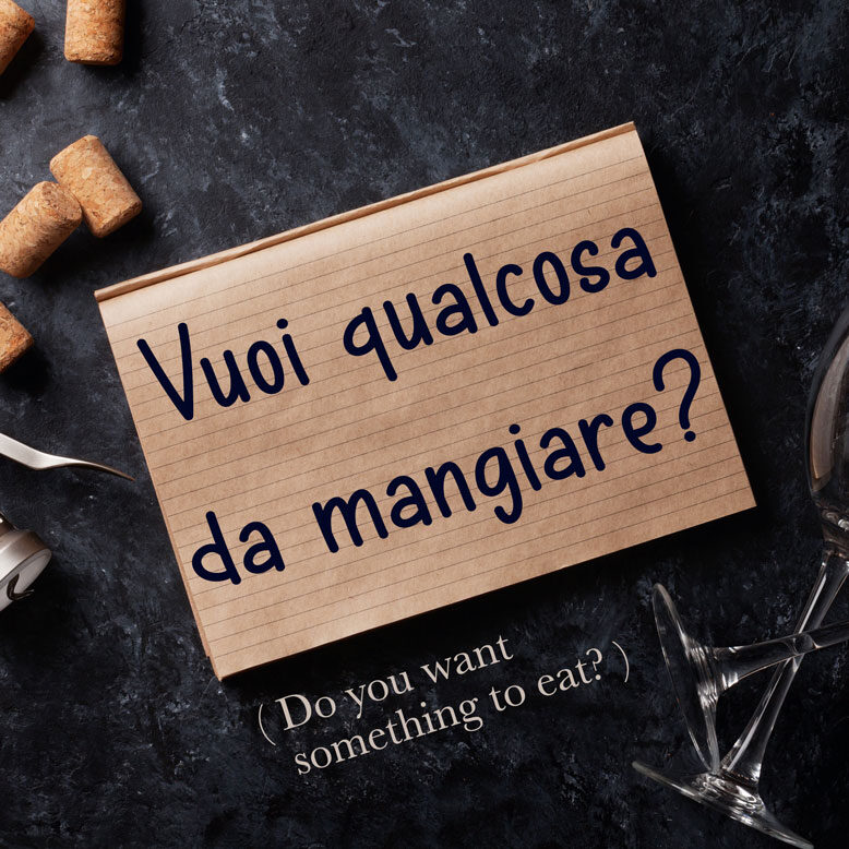 cover image with the phrase and its translation written on a notepad next to a wine glass
