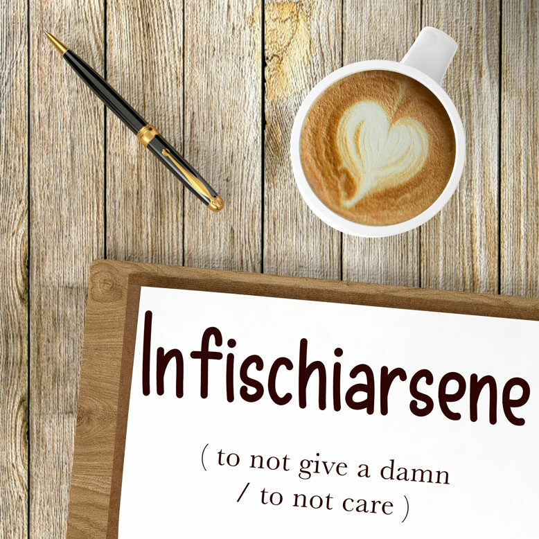 """cover image with the word """"infischiarsene"""" and its translation written on a notepad next to a cup of cofee"""