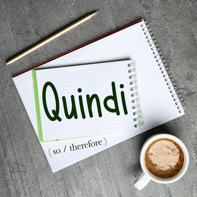 """cover image with the word """"quindi"""" and its translation written on a notepad next to a cup of cofee"""